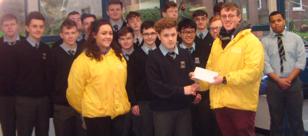 North Monastery Student council presenting a cheque for 600 Euros to share committee members